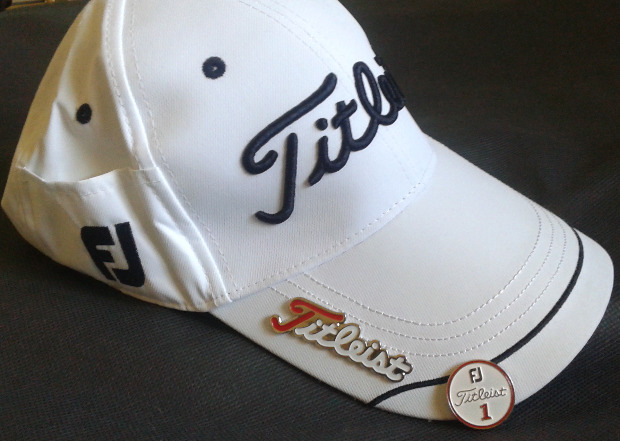 It has a metal Titleist pin that the magnetic ball marker sits on. There s  also a pocket on one side of the hat. I was wondering what the purpose was  of the ... 9e199cf2643d