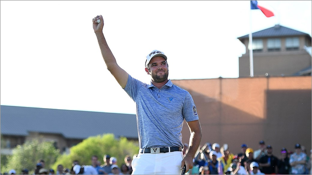 Corey Conners raises his Pro V1 golf ball In celebration after winning the 2019 Valero Texas Open