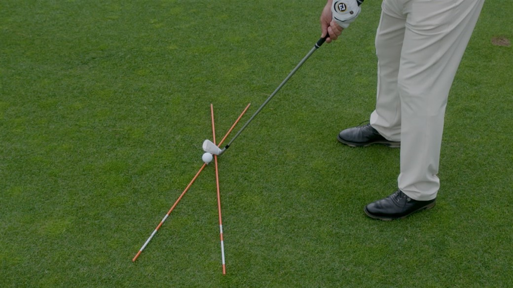 The proper setup and alignment in order to hit a fade (a shot that curves left-to-right for a right-handed golfer)