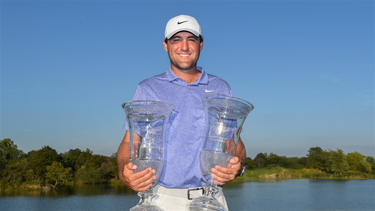 Scottie Scheffler celebrates with two trophies as Finals points leader and Regular Season points leader on the 2019 Korn Ferry Tour